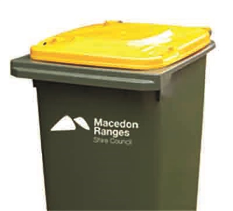 Recycling bin with yellow lid