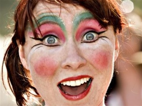 Image of a surprised woman with theatrical make-up on